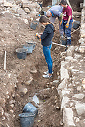 A team of archaeologists aided by a group of young volunteers is excavating an ancient site and ruins. Photographed at Magdala (Mejdel) - current day Migdal. On the Sea of Galilee, Israel  It is believed to be the birthplace of Mary Magdalene.