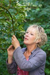 Carol Klein enjoying the scent of viburnum