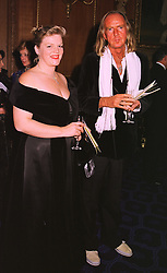 MR & MRS JOHN TAVENER he is the composer at a dinner in Berkshire on 19th November 1998.MME 120