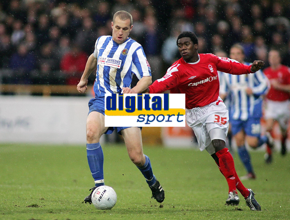 Photo: Paul Thomas.<br /> Chester City v Nottingham Forest. The FA Cup.<br /> 03/12/2005.<br /> <br /> Chester's David Artwell keeps the ball from Jon-Paul Pittman.
