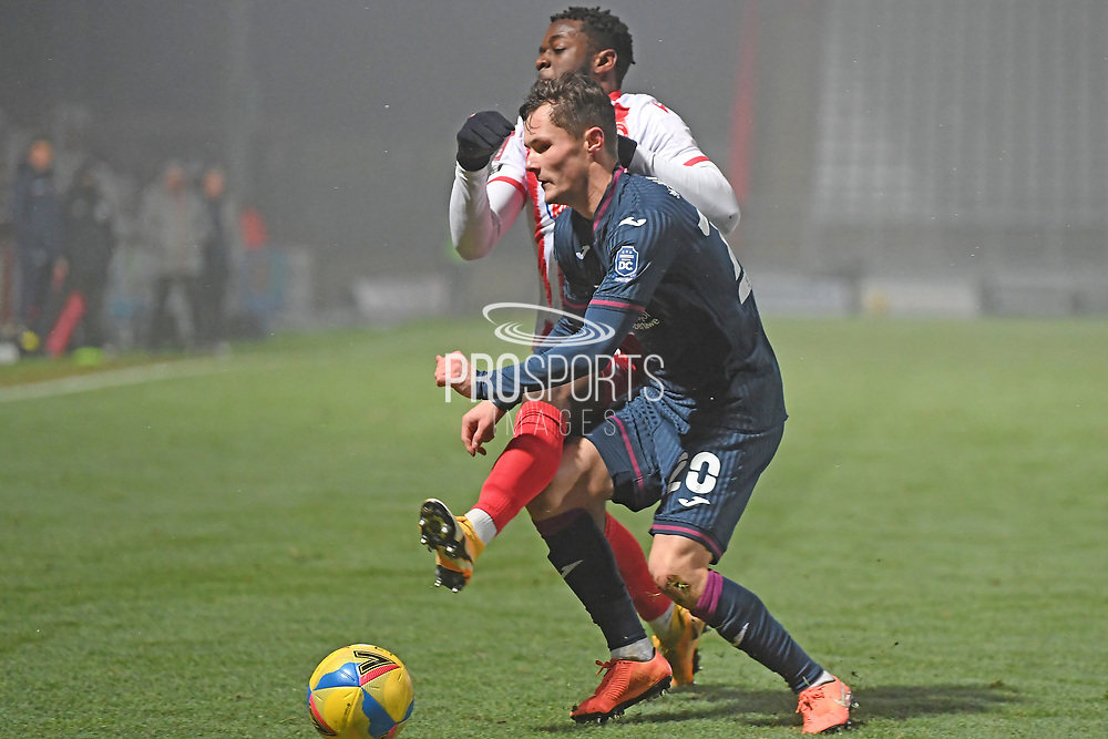 Stevenage forward Tyrone Marsh(10) and Swansea City forward Liam Cullen(20) battles for possession during the FA Cup match between Stevenage and Swansea City at the Lamex Stadium, Stevenage, England on 9 January 2021.