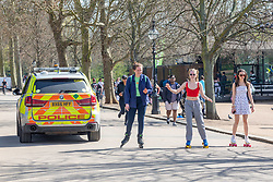 © Licensed to London News Pictures. 30/03/2021. London, UK. Police patrol Hyde Park, London for the Rule of Six' as sunbathers and picnickers enjoy the sunshine in Hyde Park, London as weather forecasters predict the hottest March in over 50 years with highs of 23c in the South East today. From yesterday, two households or six people are now allowed to meet up marking the end of the Stay at Home advice. Playing golf, tennis and organised outdoor sports is also allowed as England starts to unlock after a year of Covid-19 restrictions. Photo credit: Alex Lentati/LNP