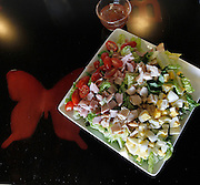 The Chef Salad has ham, chicken, cherry tomatoes, eggs, cucumber and cheese.
