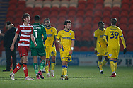 Disappointed  Wimbledon players at full time during the EFL Sky Bet League 1 match between Doncaster Rovers and AFC Wimbledon at the Keepmoat Stadium, Doncaster, England on 26 January 2021.