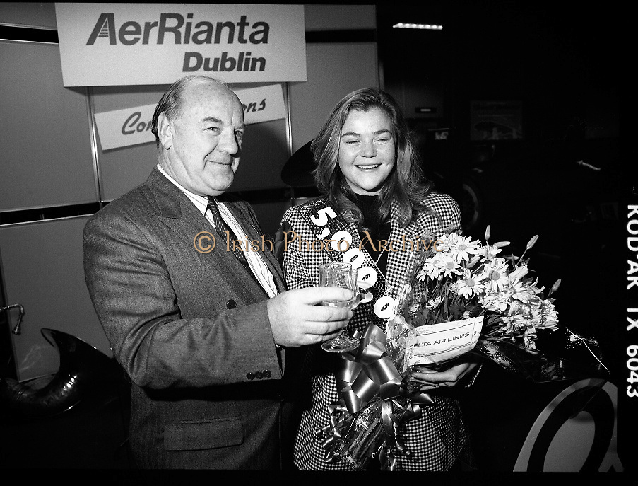 5,000,000th Passenger Through Dublin Airport. (T12).1989..22.12.1989..12.22.1989..22nd December 1989..The date,Friday,22nd December 1989 will be remembered as an historic day in Irish Aviation as Aer Rianta celebrated the 5millionth passenger to fly through Dublin Airport in one year. The Lucky passenger, Nicola Wynne, arrived at 10AM from Germany and was welcomed to Dublin Airport by General Manager,Tom Cullen...Ms Nicola Wynne and Mr Tom Cullen, General Manager, Aer Rianta pose for pictures at Dublin Airport after Nicola was named 5millionth passenger through the airport.