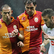 Galatasaray's Johan Elmander (C), Umut Bulut(L) and CFR Cluj's during their UEFA Champions League Group H matchday 3 soccer match Galatasaray between CFR Cluj at the TT Arena Ali Sami Yen Spor Kompleksi in Istanbul, Turkey on Tuesday 23 October 2012. Photo by Aykut AKICI/TURKPIX