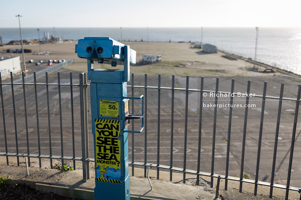Sea view telescope on West Cliff Promenade that overlooks the Port of Ramsgate, on 8th January 2019, in Ramsgate, Kent, England. The Port of Ramsgate has been identified as a 'Brexit Port' by the government of Prime Minister Theresa May, currently negotiating the UK's exit from the EU. Britain's Department of Transport has awarded to an unproven shipping company, Seaborne Freight, to provide run roll-on roll-off ferry services to the road haulage industry between Ostend and the Kent port - in the event of more likely No Deal Brexit. In the EU referendum of 2016, people in Kent voted strongly in favour of leaving the European Union with 59% voting to leave and 41% to remain.