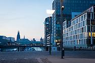 the Rheinau harbour, the office building BF 10 between the Crane Houses, in the background the cathedral, Cologne, Germany.<br /> <br /> der Rheinauhafen, das Buerogebaeude BF 10 zwischen den Kranhaeusern, im Hintergrund der Dom, Koeln, Deutschland.