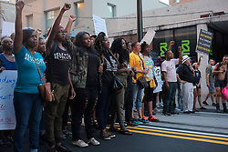 Demonstrators gather at Centennial Olympic Park in Atlanta, GA for the GA Resists Take Down White Supremacy March.  The demonstrators then proceed to march on Marietta Street, and eventually onto historic Auburn Avenue.  The event was organized by a coalition of local civil rights and social justice groups, and hosted by the Georgia Alliance for Social Justice.