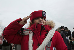 Jan 20, 2017 - Washington, District of Columbia, U.S. - A woman salutes as the Joint National Color Guard presents flags  before President Donald Trump is sworn in as the 45th President of the United States. (Credit Image: © Karen Ballard via ZUMA Wire)