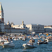 VENICE, ITALY - JULY 19: Boats and ravellers start to gather in St Mark's Basin on the day of the Redentore Celebration on July 19, 2014 in Venice, Italy. Redentore , which is in remembrance of the end of the 1577 plague, is one of Venice's most loved celebrations. Highlights of the celebration include the pontoon bridge extending across the Giudecca Canal, gatherings on boats in the St. Mark's Basin and a spectacular fireworks display.  (Photo by Marco Secchi/Getty Images)