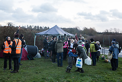 Harefield, UK. 17 January, 2020. Activists from Stop HS2 and Extinction Rebellion begin a three-day 'Stand for the Trees' protest in the Colne Valley. The event has been timed to coincide with tree felling work by HS2 adjacent to the site of Stop HS2's Colne Valley wildlife protection camp. Bailiffs acting for HS2 have been evicting Stop HS2 activists from the camp for the past week and a half. 108 ancient woodlands are set to be destroyed by the high-speed rail link.
