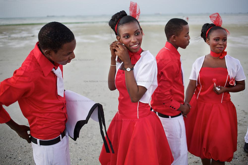A wedding party gather for photographs on the beach in Dar es Salaam...Photo: Tom Pietrasik.Dar es Salaam, Tanzania.June 25th 2011