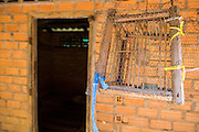 29 OCTOBER 2012 - MAYO, PATTANI, THAILAND:  An empty songbird cage hangs in front of a patient's room at the Bukit Kong home in Mayo, Pattani. The home opened 27 years ago as a Pondo School, or traditional Islamic school, in the Mayo district of Pattani. Shortly after it opened, people asked the headmaster to look after individuals with mental illness. The headmaster took them in and soon the school was a home for the mentally ill. Thailand has limited mental health facilities and most are in Bangkok, more than 1,100 kilometers (650 miles) away. The founder died suddenly in 2006 and now his widow, Nuriah Jeteh, struggles to keep the home open. Facilities are crude by western standards but the people who live here have nowhere else to go. Some were brought here by family, others dropped off by the military or police. The home relies on donations and gets no official government support, although soldiers occasionally drop off food. Now there are only six patients, three of whom are kept chained in their rooms.  Jeteh says she relies on traditional Muslim prayers, holy water and herbal medicines to treat the residents. Western style drugs are not available and they don't have a medic on staff.    PHOTO BY JACK KURTZ
