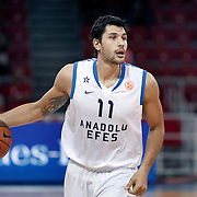Anadolu Efes's Cenk AKYOL during their Two Nations Cup basketball match Anadolu Efes between Olympiacos at Abdi Ipekci Arena in Istanbul Turkey on Sunday 02 October 2011. Photo by TURKPIX