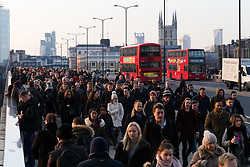 © Licensed to London News Pictures. 04/01/2019. London, UK.  Commuters walk to work across London Bridge during cold weather in the capital this morning.  Photo credit: Vickie Flores/LNP