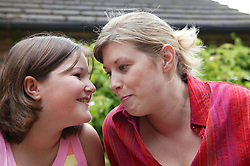 Young girl developing a trusting and close relationship with her mentor; part of the Independent Visitors Scheme,