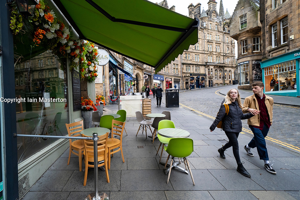 Edinburgh, Scotland, UK. 14 November 2020. Views of Edinburgh city centre on Saturday afternoon during a level 3 lockdown imposed by the Scottish Government;.Pictured;  Cafes on Cockburn Street in Old Town are empty. Iain Masterton/Alamy Live News.