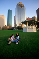 Stock photo of a man and two women enjoying the park on a nice evening