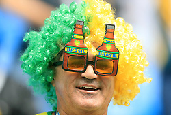 A Brazil fans shows his support ahead of the match