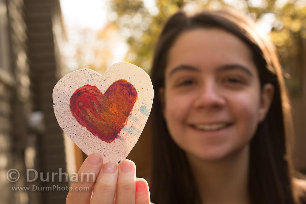 Isabel holding an original art card. Model and original art released.