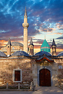 The outer wall will small domed Dervish lodges of the Mevlâna museum,  the mausoleum of Jalal ad-Din Muhammad Rumi, a Sufi mystic also known as Mevlâna or Rumi. It was also the dervish lodge (tekke) of the Mevlevi order, better known as the whirling dervishes. Mevlâna died on 17 December 1273. Konya, Turkey .<br /> <br /> If you prefer to buy from our ALAMY PHOTO LIBRARY  Collection visit : https://www.alamy.com/portfolio/paul-williams-funkystock/konya.html<br /> <br /> Visit our TURKEY PHOTO COLLECTIONS for more photos to download or buy as wall art prints https://funkystock.photoshelter.com/gallery-collection/3f-Pictures-of-Turkey-Turkey-Photos-Images-Fotos/C0000U.hJWkZxAbg