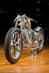 An all electric chopper, named AlSi9Mg (from the aluminum chemical mixture used for the bike) built by Enrico de Haas from Huettenberg, Germany. The motor is hidden in what you may think is an oil bag and most of the bike is more like a one-off sculpture. Mama Tried Show, Milwaukee, WI. USA. Friday February 23, 2018. Photography ©2018 Michael Lichter.
