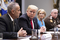 December 18, 2018 - Washington, DC, United States of America - U.S. President Donald Trump, center, listens to Andy Pollack, the father of a Marjory Stoneman Douglas High School shooting victim, left, during a meeting on the School Safety report, in the Roosevelt Room of the White House December 18, 2018 in Washington, DC. The 177-page report by the U.S. Education Department contains nearly 100 recommendations, but does not address the key demands for gun control made by school shooting victims and students. (Credit Image: © Joyce N. Boghosian via ZUMA Wire)