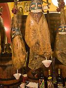 Jamones smoked ham hanging in traditional bar Ronda, Spain