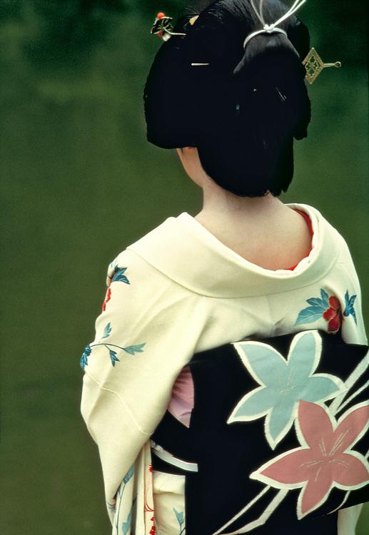 A model, in a formal kimono, pauses in Ritsurin Park, Takamatsu, Shikoku, Japan.