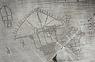 """Petroglyph, rock carving, detail of the so called """"Village"""" depicting two storey houses built on poles . Carved by the ancient Camunni people in the iron age between 1000-1600 BC. Rock no 24,  Foppi di Nadro, Riserva Naturale Incisioni Rupestri di Ceto, Cimbergo e Paspardo, Capo di Ponti, Valcamonica (Val Camonica), Lombardy plain, Italy .<br /> <br /> Visit our PREHISTORY PHOTO COLLECTIONS for more   photos  to download or buy as prints https://funkystock.photoshelter.com/gallery-collection/Prehistoric-Neolithic-Sites-Art-Artefacts-Pictures-Photos/C0000tfxw63zrUT4<br /> If you prefer to buy from our ALAMY PHOTO LIBRARY  Collection visit : https://www.alamy.com/portfolio/paul-williams-funkystock/valcamonica-rock-art.html"""