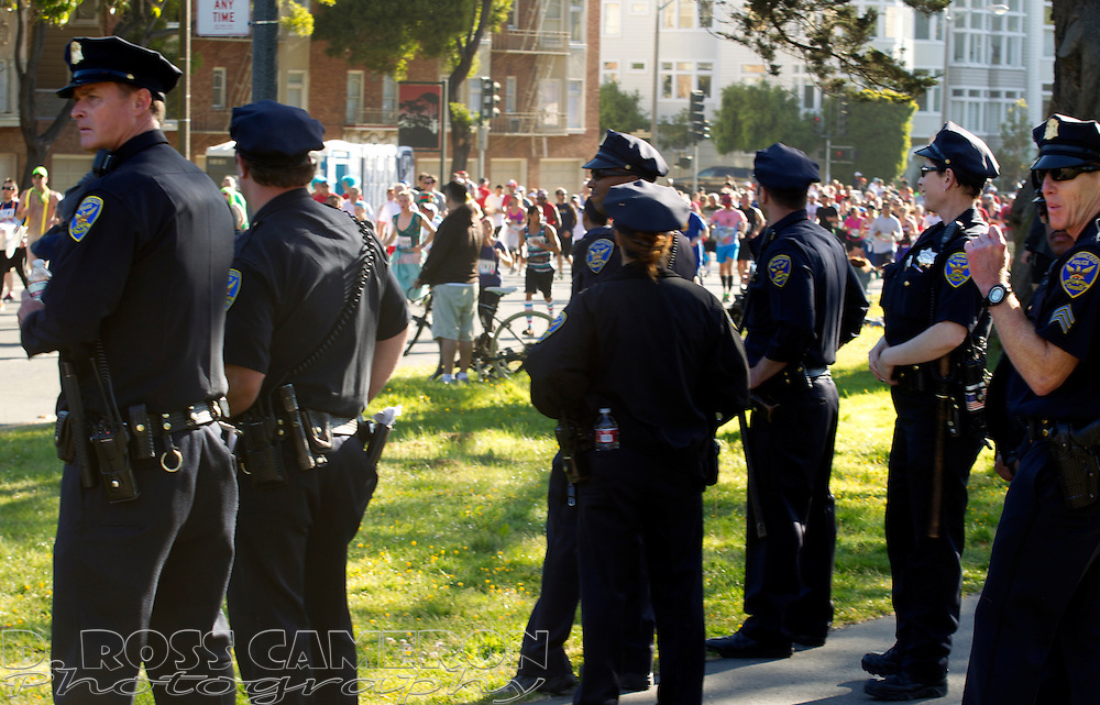 San Francisco police officers keep watch from the panhandle of Golden Gate Park during the 102nd running of the Bay to Breakers 12K in San Francisco, Sunday, May 19, 2013. Security for the race was stepped up in the aftermath of the Boston Marathon bombings. (Photo by D. Ross Cameron)
