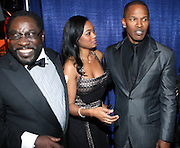 l to r: Eddie Levert, Tatiana Ali, and Jamie Foxx at the The Radio One Inaugural Celebration 2009 Hennessey VIP Lounge Salute held at Lincoln Theater in Washington, DC on January 17, 2009..CATHY HUGHES, RADIO ONE FOUNDER AND CHAIRPERSON had a Hometown Inaugural Salute to President Barack Obama and Tom Joyner at the Lincoln Theater in Washington DC. Hennessy hosted celebrities and guests in a branded Hennessy lounge where Tatiana Ali interviewed celebrities about their feelings toward the Barack Obama Presidency. Celebrities in attendance included Jamie Foxx, Alonzo Morning, Eddie Levert, T. D. Jakes, Rev. Al Sharpton, Jackie Reid, Roland Martin, Dick Gregory, Raheem DaVaughn, Bow Bow, and more. Hennessy presented a commemorative Hennessy 44 Bottle which was signed by numerous celebrities which will be auctioned to create 4 four-year scholarships via the Thrugood Marshall College Fund...