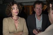 Olatz Schnabel and Geoffrey Rush. George Rush. Talk pre-Golden Globes party. Mondrian Hotel. 20 January 2001. © Copyright Photograph by Dafydd Jones 66 Stockwell Park Rd. London SW9 0DA Tel 020 7733 0108 www.dafjones.com