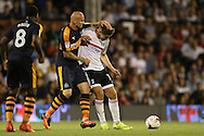 Jonjo Shelvey of Newcastle United fouls Tom Cairney of Fulham. Skybet EFL championship match, Fulham v Newcastle Utd at Craven Cottage in Fulham, London on Friday 5th August 2016.<br /> pic by John Patrick Fletcher, Andrew Orchard sports photography.