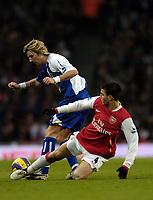 Photo: Olly Greenwood.<br />Arsenal v Blackburn Rovers. The Barclays Premiership. 23/12/2006. Blackburn's Robbie Savage tackled by Arsenal's Cesc Fabregas