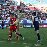 Russia goalkeeper Elvira Todua (1) stops a shot on goal during an international friendly soccer match between the United States Women's National soccer team and the Russia National soccer team at FAU Stadium on Saturday, February 8, in Boca Raton, Florida. The U.S. won the match by a score of 7-0. (AP Photo/Alex Menendez)