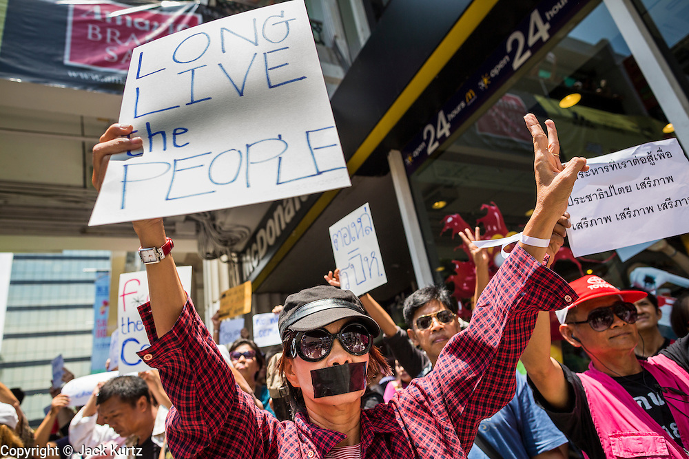 """25 MAY 2014 - BANGKOK, THAILAND:  Thai """"Red Shirt"""" protestors opposed to the military junta at a demonstration in Bangkok. Public opposition to the military coup in Thailand grew Sunday with thousands of protestors gathering at locations throughout Bangkok to call for a return of civilian rule and end to the military junta.    PHOTO BY JACK KURTZ"""
