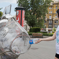 Fish wire sculpture eating plastic trash is put on display to raise awareness for climate change and the ecologic consequences of disposable plastic bags and packaging and promoting the Plastic Free July movement to avoid these products for a month in downtown Budapest, Hungary on July 20, 2020. ATTILA VOLGYI