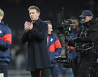 Football - 2019 / 2020 UEFA Champions League - Round of Sixteen, First Leg: Tottenham Hotspur vs. RB Leipzig<br /> <br /> Leipzig Manager / coach, Julian Nagelsmann salutes his fans after the match, at The Tottenham Hotspur Stadium.<br /> <br /> COLORSPORT/ANDREW COWIE