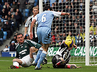 Photo: Paul Thomas.<br /> Manchester City v Newcastle United. The Barclays Premiership. 11/11/2006.<br /> <br /> Claudio Reyna (6) of Man City shoot's for goal, but it is blocked by Newcastle's Peter Ramage (R). There is an appeal, but it is turned down.