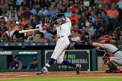 May 23, 2018 - Houston, TX, U.S. - HOUSTON, TX - MAY 23: Houston Astros shortstop Carlos Correa (1) makes contact for a single in the fifth inning during MLB baseball game between the Houston Astros and the San Francisco Giants on May 23, 2018 at Minute Maid Park in Houston, Texas. (Photo by Juan DeLeon/Icon Sportswire) (Credit Image: © Juan Deleon/Icon SMI via ZUMA Press)