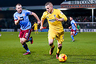 AFC Wimbledon midfielder Dean Parrett (18)  gets away from Scunthorpe United midfielder Stephen Dawson (8)  during the EFL Sky Bet League 1 match between Scunthorpe United and AFC Wimbledon at Glanford Park, Scunthorpe, England on 28 February 2017. Photo by Simon Davies.