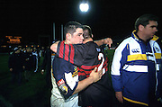 Hookers Jeremy Paul (L) and Mark Hammett hug after the match, Crusaders v ACT Brumbies, Super 12 Final, rugby union, Bruce Stadium, Canberra, Australia, 27 May 2000. © Copyright Photo: Dean Treml / www.photosport.nz
