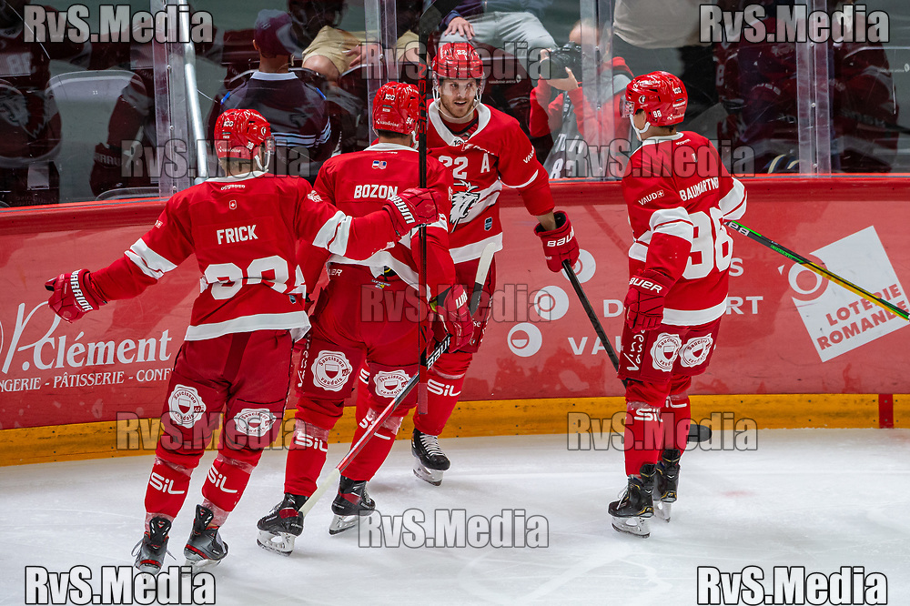 LAUSANNE, SWITZERLAND - SEPTEMBER 24: Christoph Bertschy #22 of Lausanne HC celebrates his goal with teammates during the Swiss National League game between Lausanne HC and HC Davos at Vaudoise Arena on September 24, 2021 in Lausanne, Switzerland. (Photo by Robert Hradil/RvS.Media)