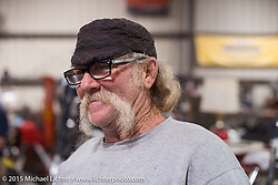 "Tim at Bill Dodge's ""Blings Cycles"" custom shop while friends meet up and work on their bikes after a long day at Daytona Beach Bike Week 2015. FL, USA. Monday March 9, 2015.  Photography ©2015 Michael Lichter."