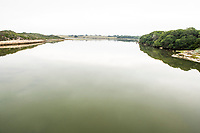 Tranquil green colored estuarine river, De Mond Nature Reserve, Western Cape, South Africa