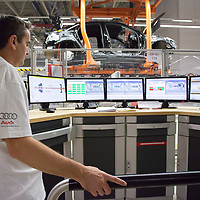 Worker monitors the assembly procedure of a car belonging to the Audi TT family in the Audi factory in Gyor (about 120 km West of Budapest), Hungary on November 05, 2014. ATTILA VOLGYI