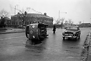 16/02/1963<br /> 02/16/1963<br /> 16 February 1963<br /> Volkswagen van overturned at Griffith Avenue, Dublin.<br /> The driver of this van made scrambled eggs of his load when he overturned at the junction of Griffith Avenue and Upper Drumcondra Road. Whitehall Garda station in the background.
