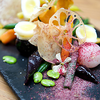 Intricate shapes, delicate flowers, and rich colours combine in this dish as renowned Circa restaurant in St Kilda, Victoria, Australia.